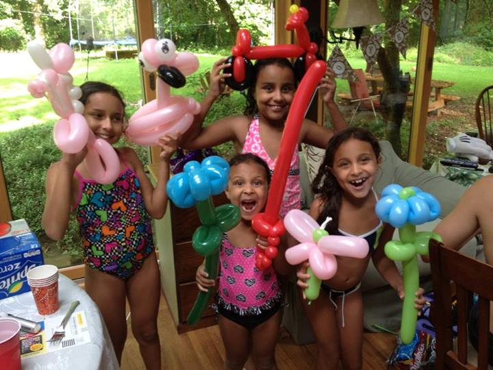 My nieces with a bevy of twisted balloon animals and arrangements by Twister Vic