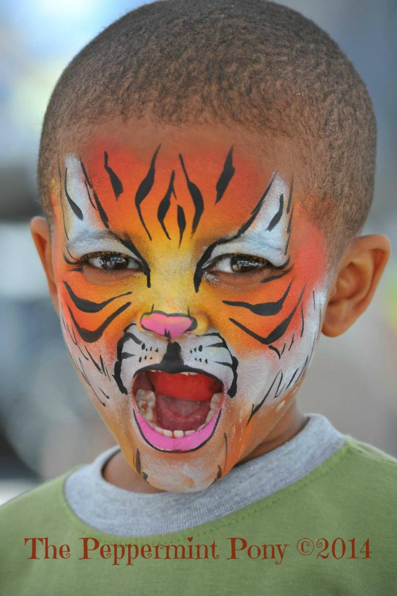 Tiger face painting in Frederick MD with The Peppermint Pony