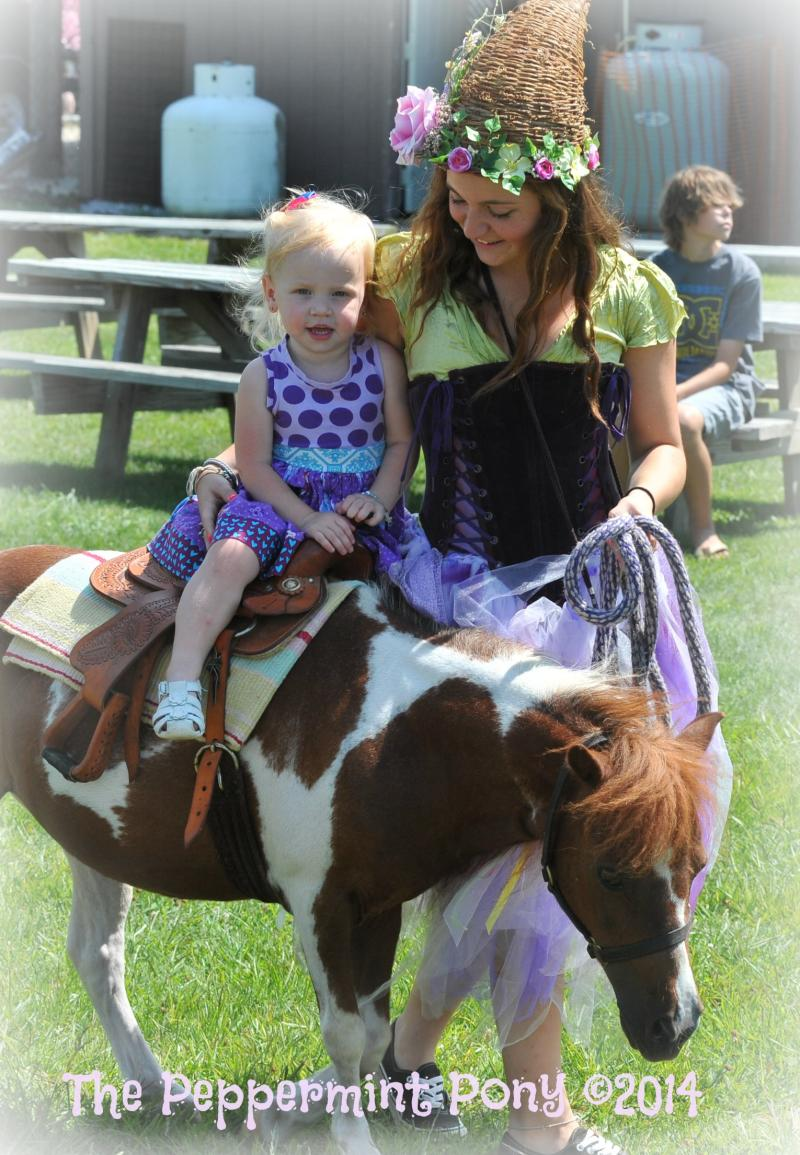 Woodland Faerierica leading a little girl on our mini horse Pocahontas
