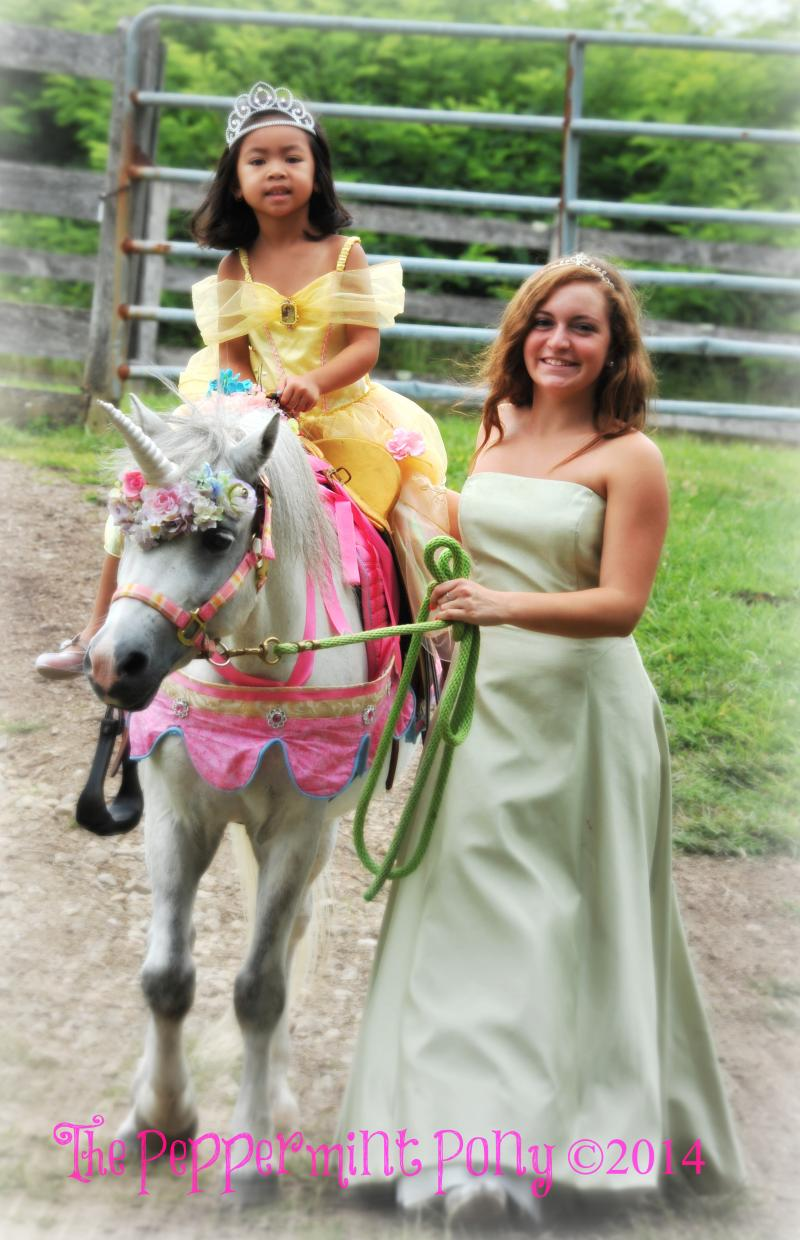 A pair of princesses, one riding and one leading a real unicorn in Highland, MD