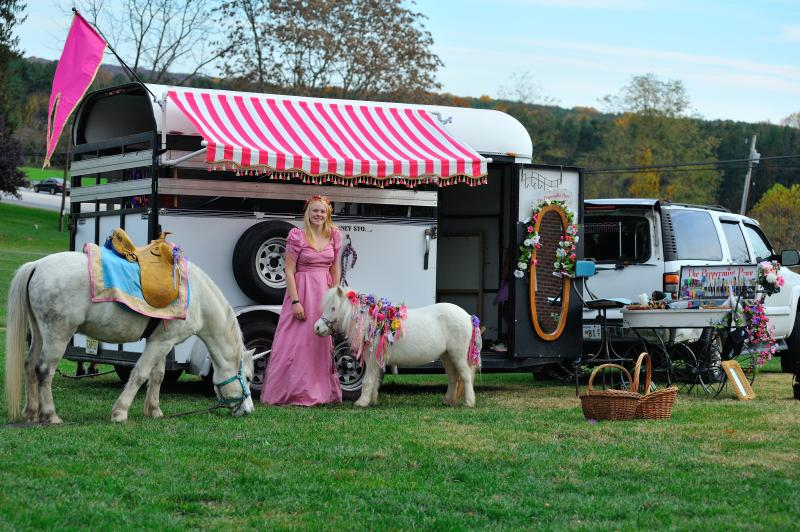 Princess, Unicorn and mini horse in front of our horse trailer ready to party